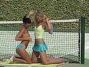 Two sexy tennis players explore holes with fingers on the tennis court