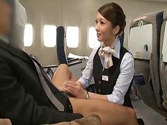 Nasty Asian Stewardess Gives A Rub And A Tug