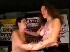 Hot Sluts Show Off Their Tits While On Stage