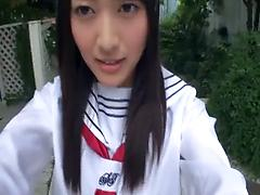 Black-haired Japanese chick jerks off cock and enjoys crazy banging