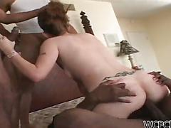 Horny white slut gets roughly fucked by three black cocks