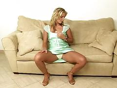 Blonde solo girl fingers and inserts toy in her pussy hole on a sofa