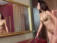 Bety stretches pussy lips and plunges her long fingers in vagina