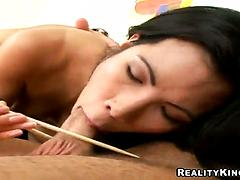 Raven-haired Asian babe Asia De Ville stuffed with two huge cocks