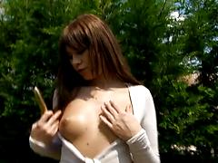 Yummy babe strips in the garden and smashes pussy with a vibrator