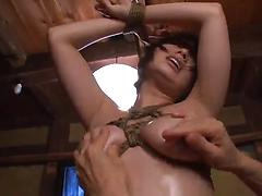 Bound Asian girl gets nipples pinched and snatch smashed