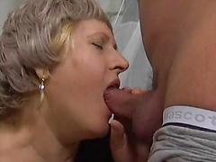 Fat mature with big floppy boobs blows and rides hard rod